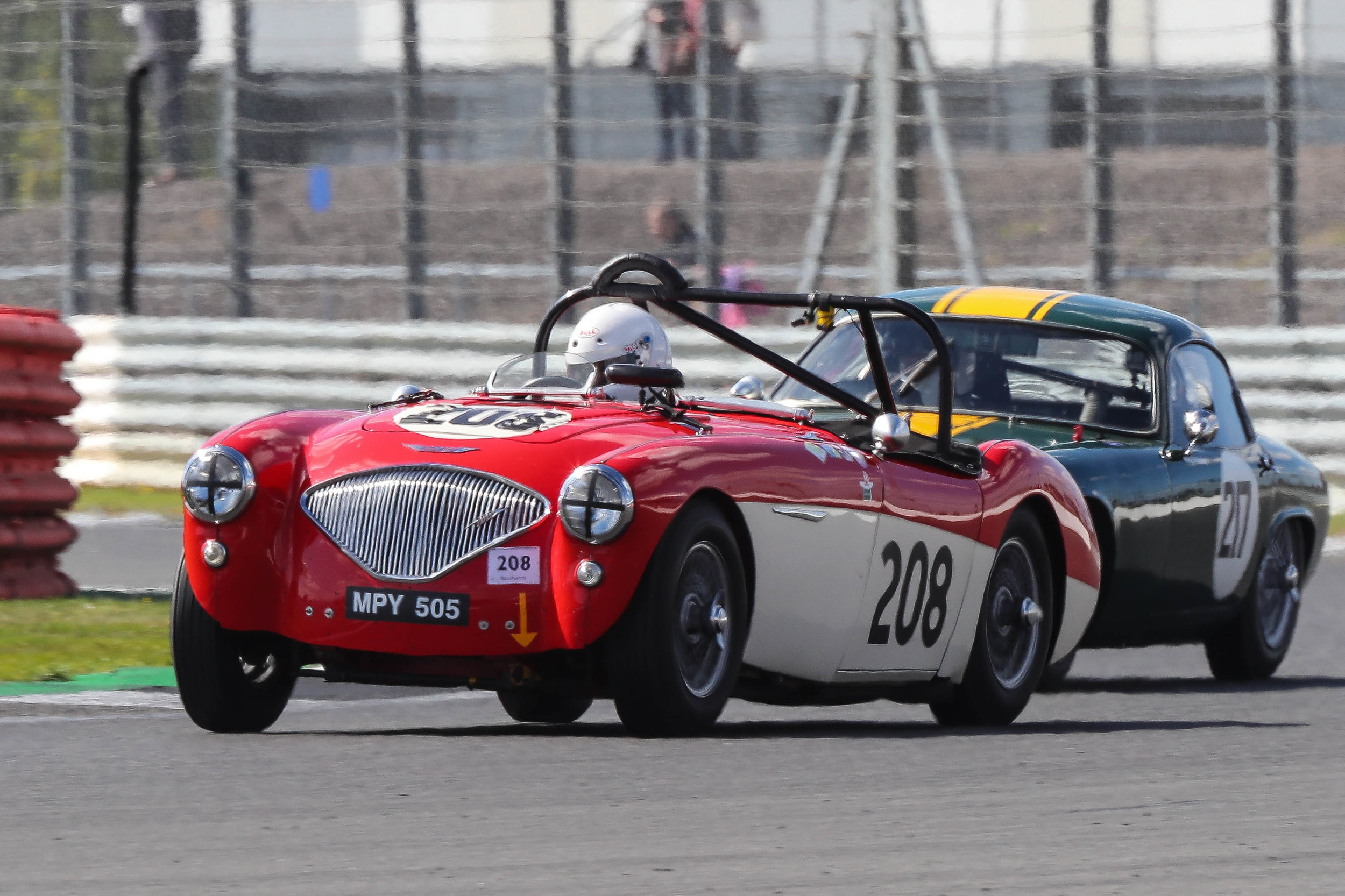 Paul Mortimer in his Austin Healey about to be overtaken by Mike Freeman in the Elite                          Photo - Richard Styles