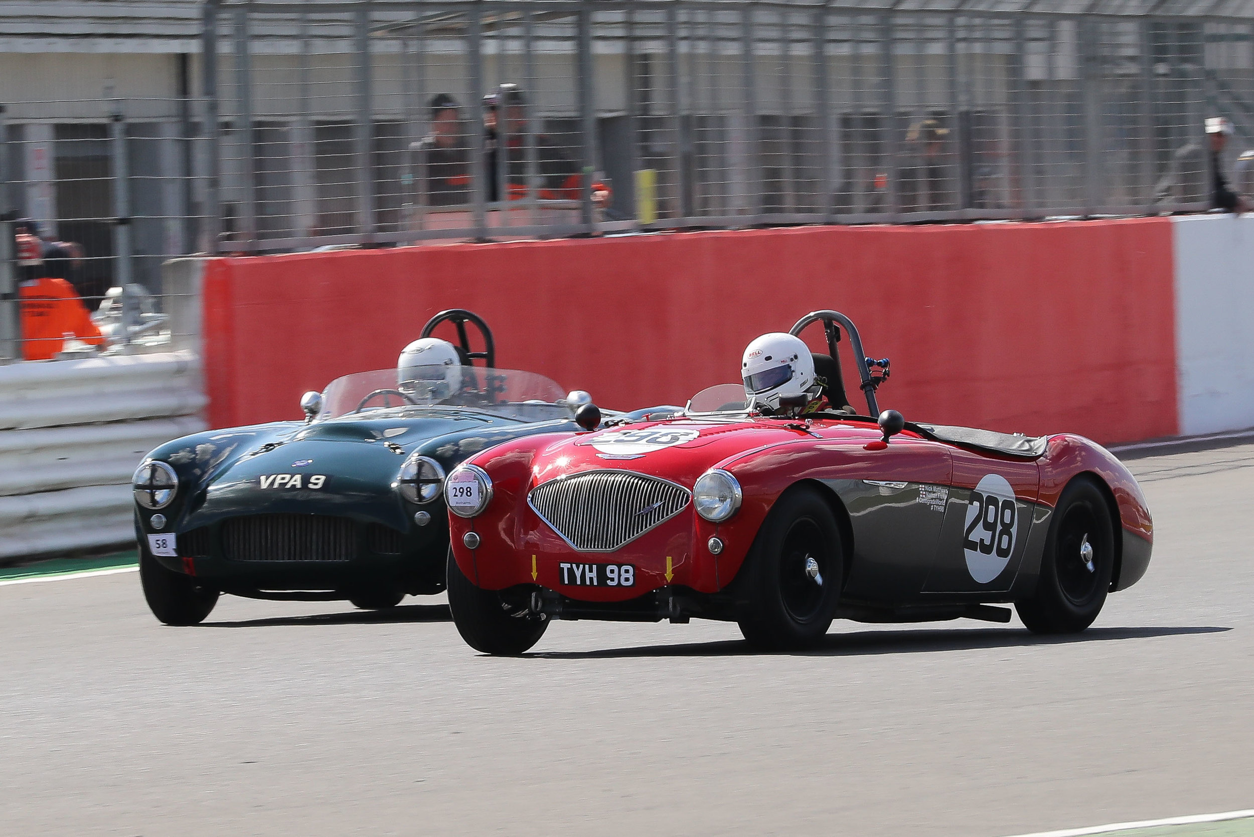 Nick Matthews, always highly competitive, led the Austin Healey charge for the early laps. Here he is being passed by the recovering HWM of Martin Hunt.                                                                                                                                  Photo - Richard Styles