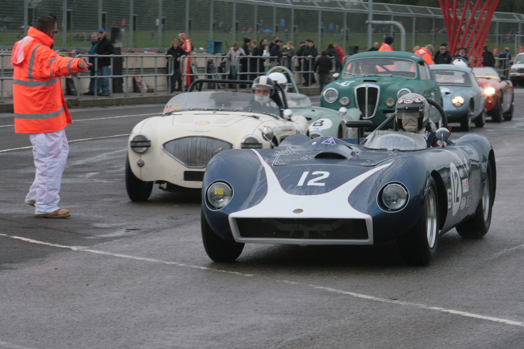 Richard Tyzack's Kellison J4R heads out for qualifying whilst Marc Mezey awaits clearance in the Austin Healey and directly behind in the green Lancia Aurelia is Andrew Davenall- all 3 drivers new to FISCAR Photo - John Turner