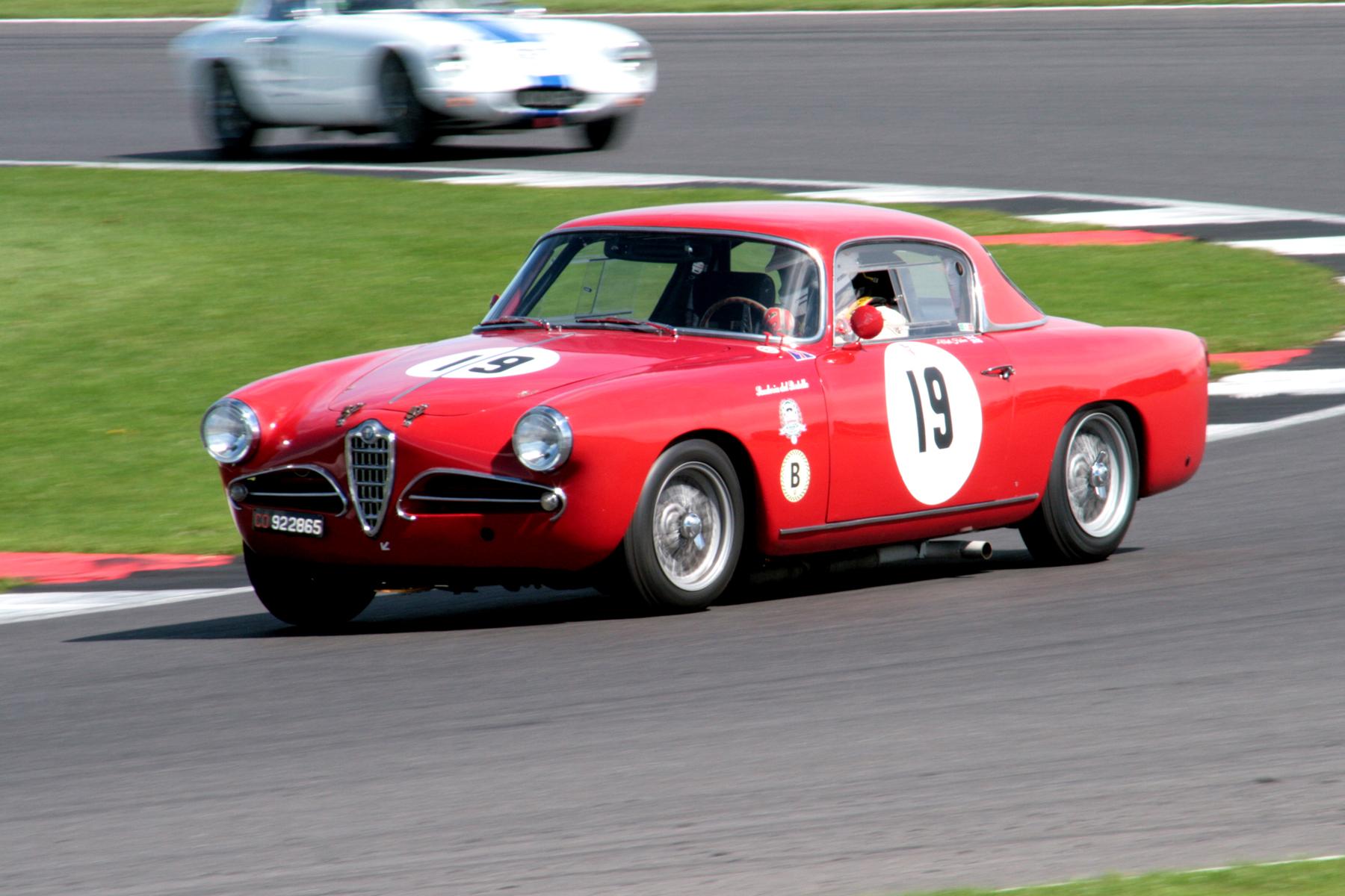 Matthew Holme in the stunning Alfa, presses on                                Photo - John Turner
