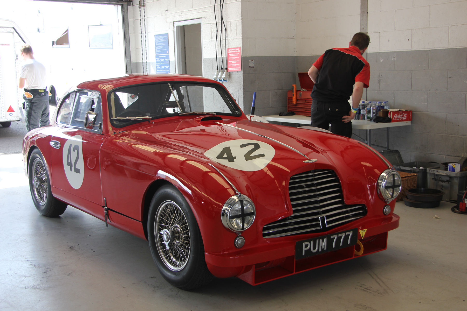Paul Chase-Gardener's iconic Aston Martin DB2 at rest in the pitlane garage prior to the race start.                                   Photo - Pat Arculus, Tripos Media