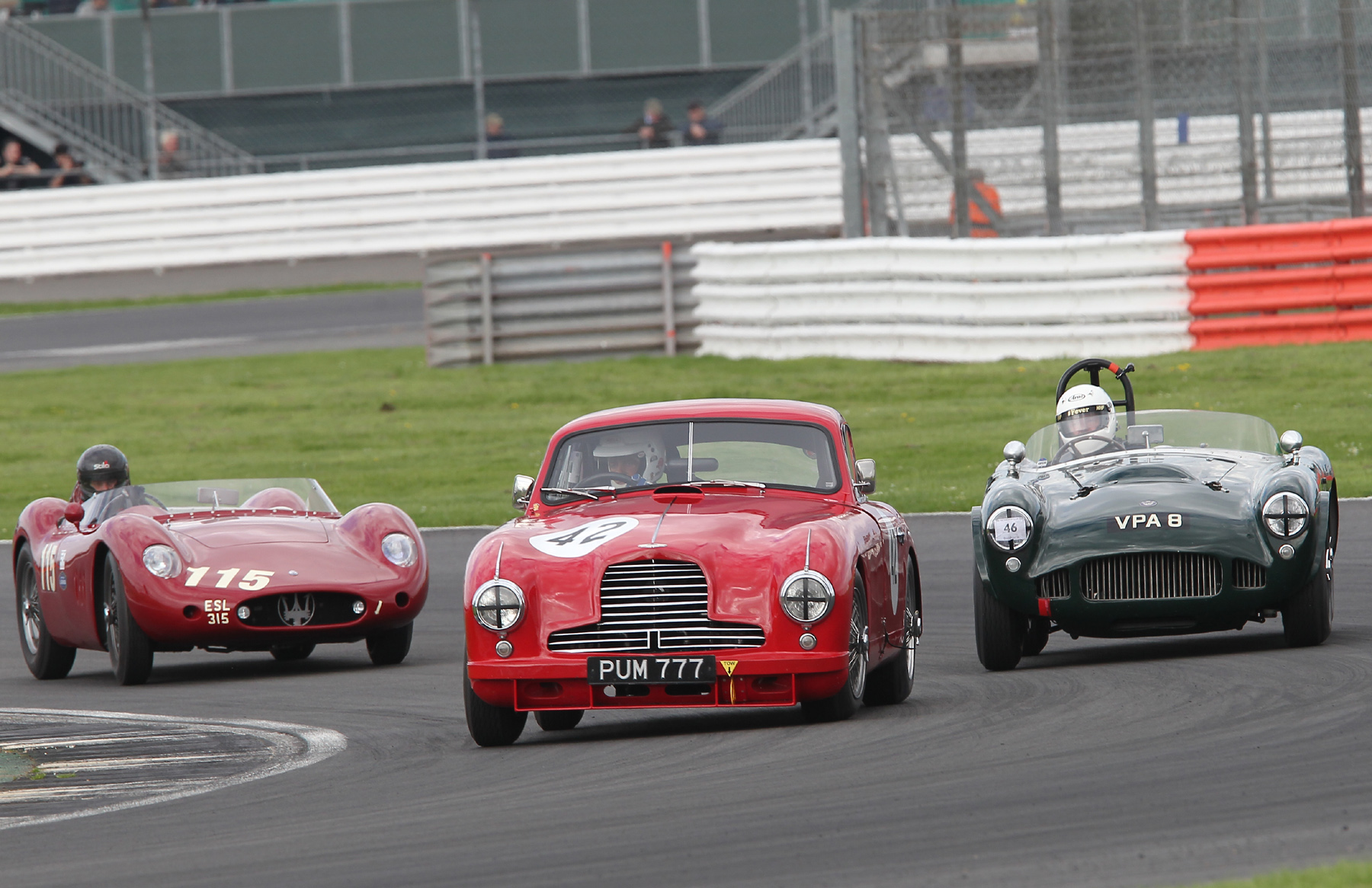 Martin Hunt still just has the lead as he and Richard Wilson come up to lap Paul Chase-Gardener in the Aston Martin DB2. What a fabulous trio of cars , captured superbly by Mick Walker.
