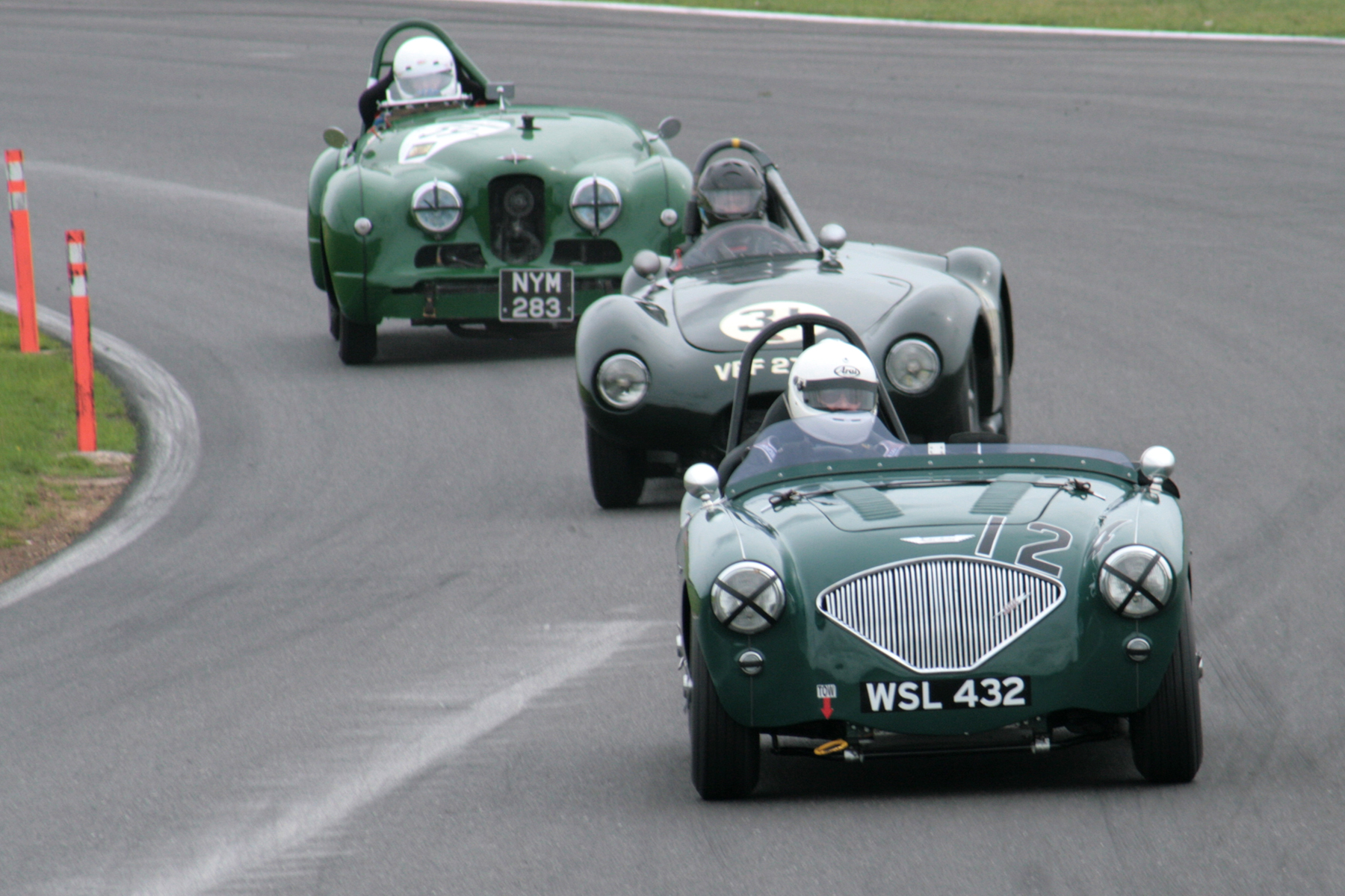 Various hues of BRG! Jim Campbell (Austin Healey 100/4, Paul Griffin (Connaught L2) & Harry Naerger (Jowett Jupiter). A Terrific sight!  Photo - John Turner