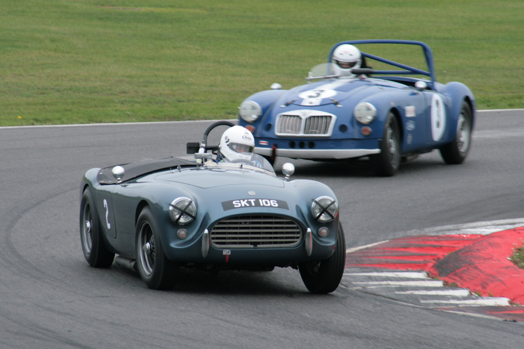 Mark Morgan (AC Ace Bristol) being chased by Philip Elder in the MGA  Photo - John Turner