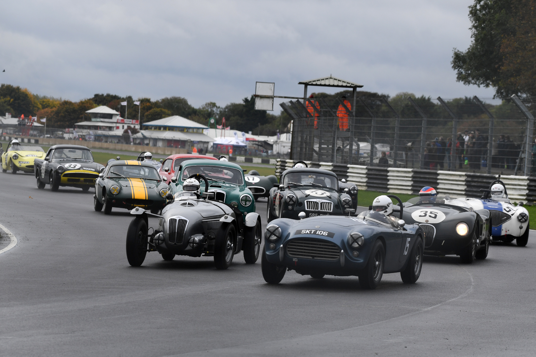Massed ranks of glorious cars. All the cars in the previous photo above have gone through but look at this! There's more! Mark Morgan (AC Ace) and Patrick Blakeney- Edwards in Ned Spieker's Frazer Nash High Speed model lead a pack of chasing cars.  Photo - Jeff Bloxham