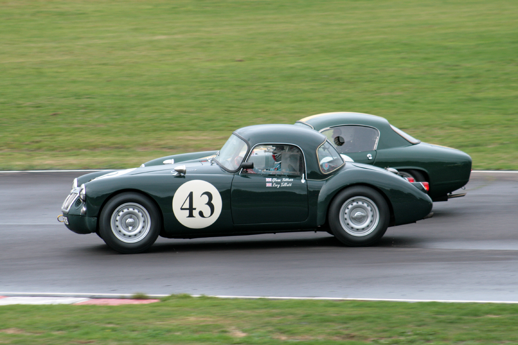 Glenn Tollett (MGA) & Mike Freeman (Lotus Elite) side by side through the Esses for the first time. Glenn had dropped back, whilst Mike had made some places, not entirely unexpectedly.  John Turner