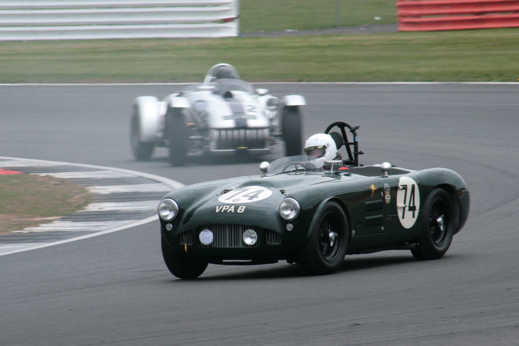 Martin Hunt in the HWM Jaguar had to work extremely hard to overcome the Kurtis 500S of Chris Keen. The Kurtis is partly obscured here by smoke trailing from the ailing Cooper Monaco of Andrew Smith which was soon to retire. Photo - John Turner