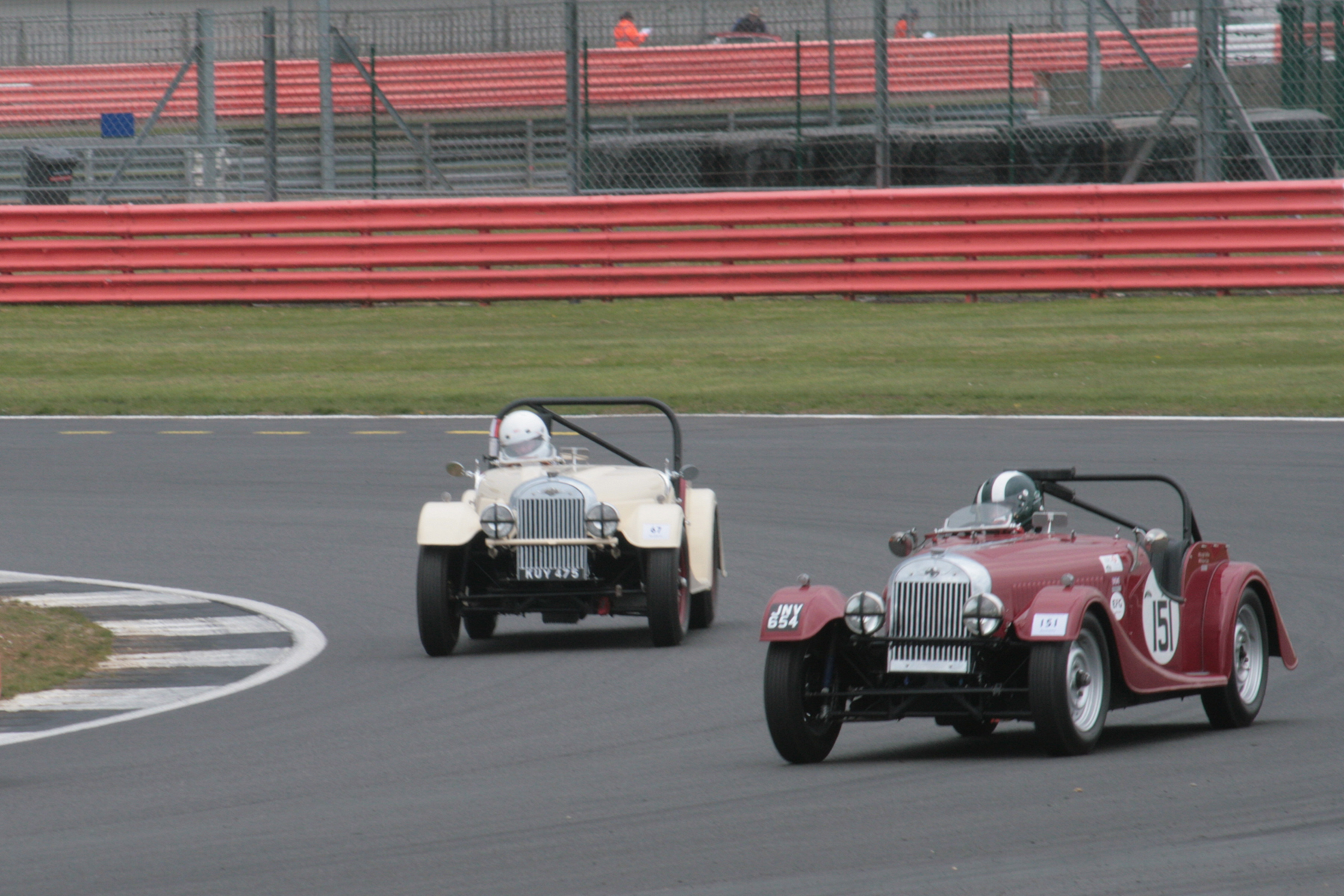 The splendid and rare sight of two Flat Rad Morgan Plus 4s - Leigh Sebba and Mark Shears battle it out. They were even closer at the flag  Photo - John Turner