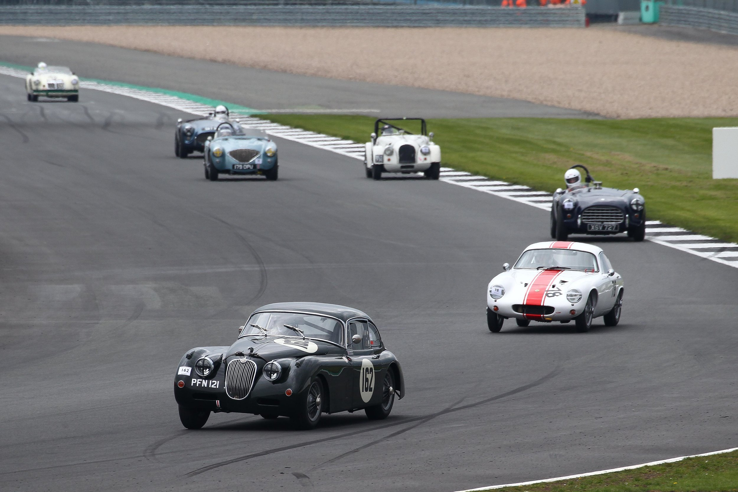 A great string of FISCAR cars. Graham Love (XK150) leads John Waterson (Lotus Elite), Justin Beckett (AC Ace), Alan House (Morgan Plus 4), Robert Clarke (Austin Healey 100), Mark Morgan (AC Ace) and Nick Burnside (MGA Twin Cam). Photo - Richard Styles