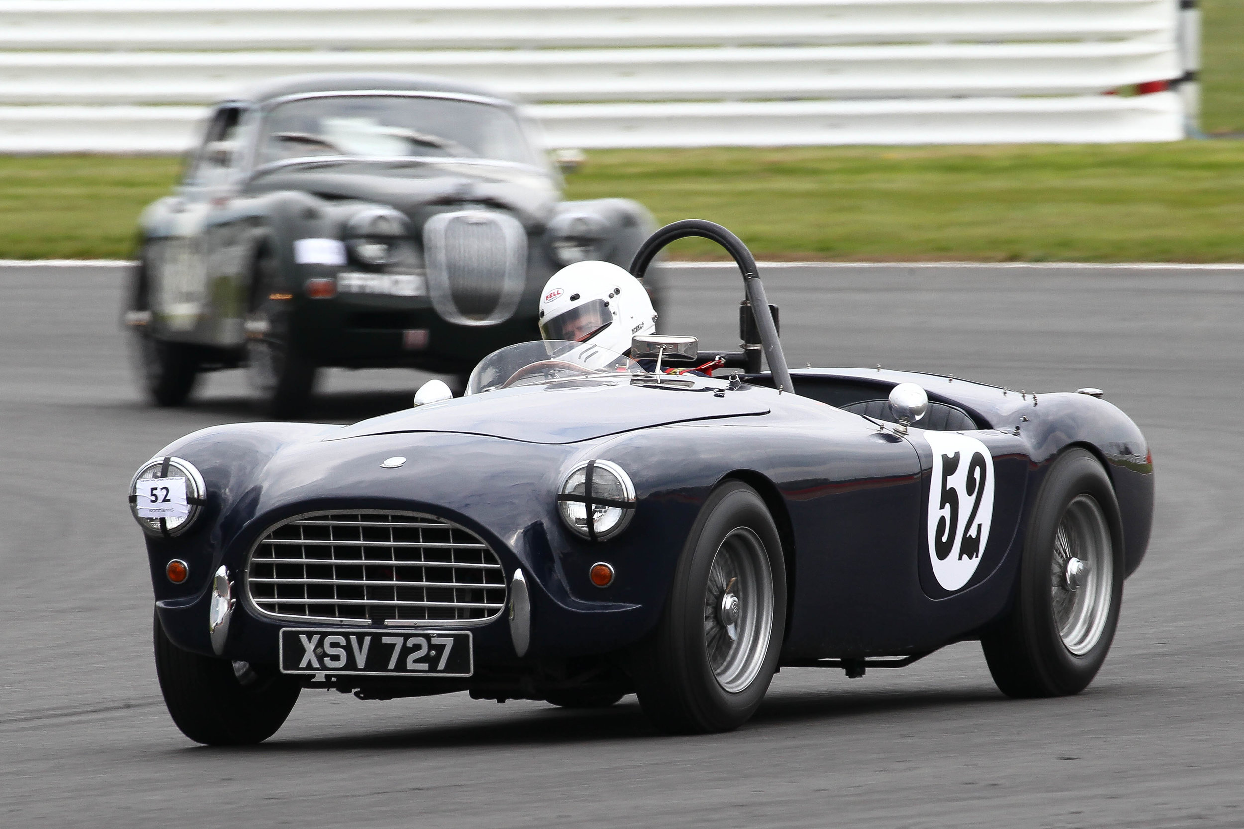 Justin Beckett (AC Ace) leads Graham Love (Jaguar XK150). The Jaguar was in front at the flag. Photo - Richard Styles