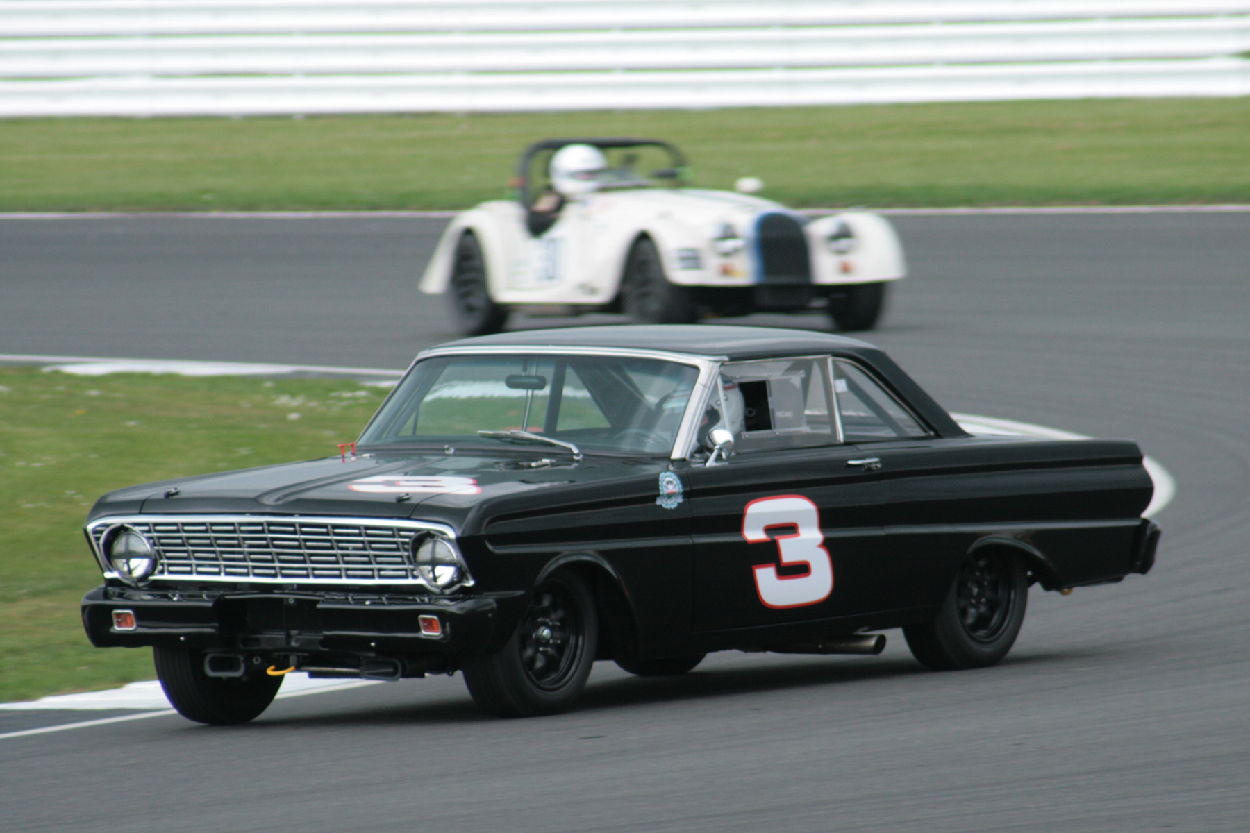 The Leo Voyazides/Simon Hadfield Ford Falcon was 5th overall and won the invitation Historic Touring car class. This is Simon driving.  Photo - John Turner