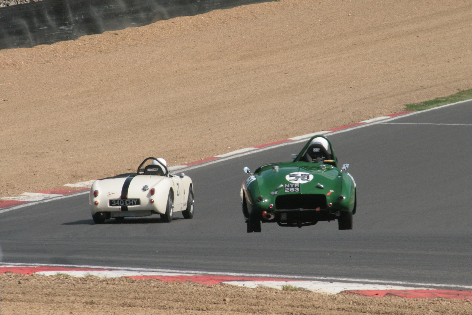 Neil Cameron (Frogeye) and Harry Naergar (Jowett Jupiter) in Clark Curve. Photo - John Turner