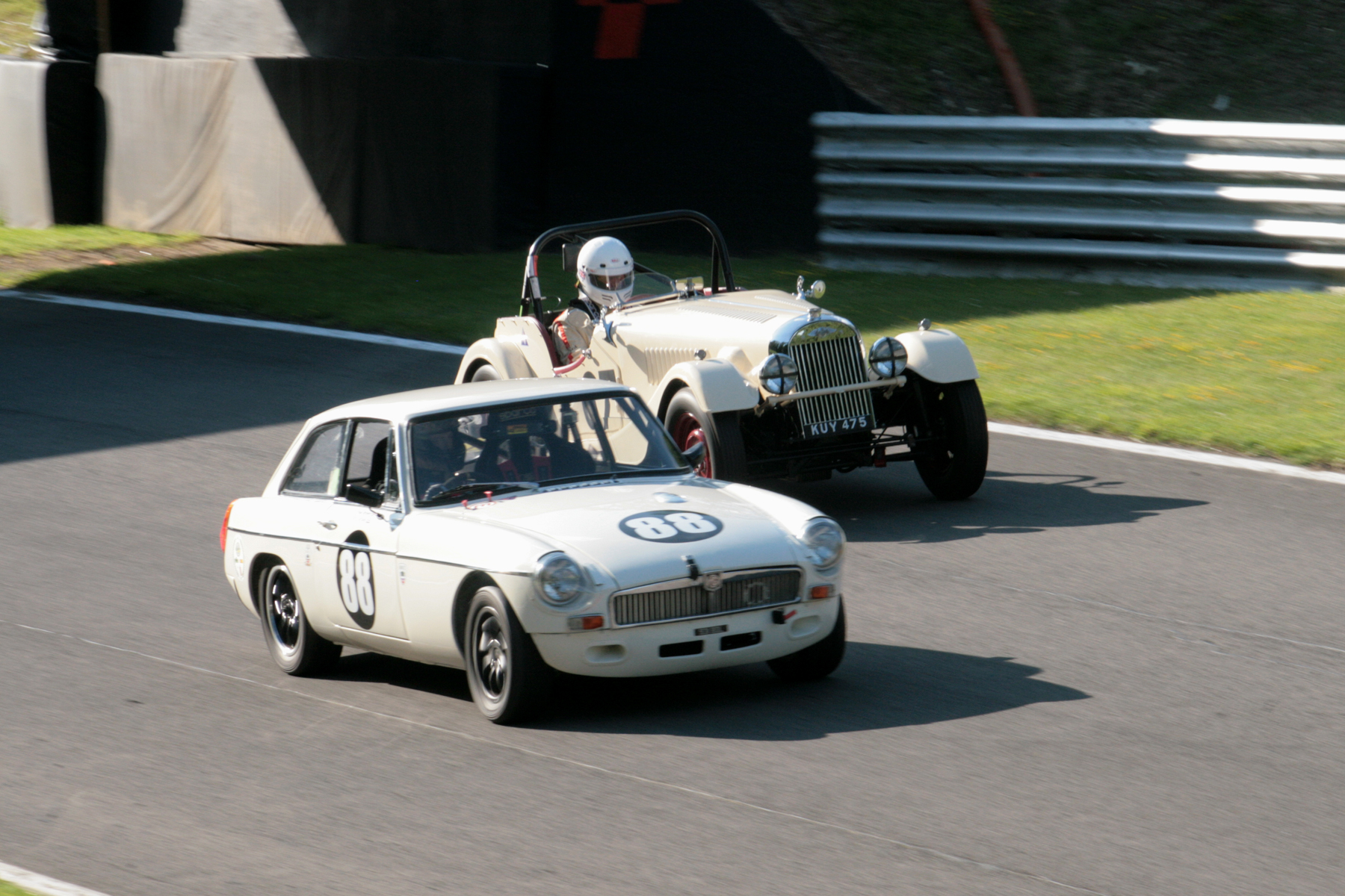 Mark Shears is passed by Harry Brown in the MGB GT
