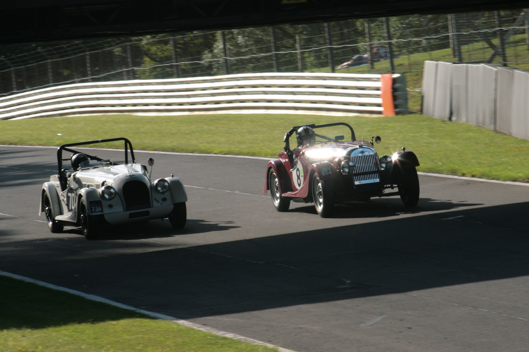 Alan House takes his Morgan +4 (70) passed Leigh Sebba's earlier model (8) as they charge down Pilgrim's Drop and under the roadbridge. However, Alan was to retire at the end of the lap with power loss.