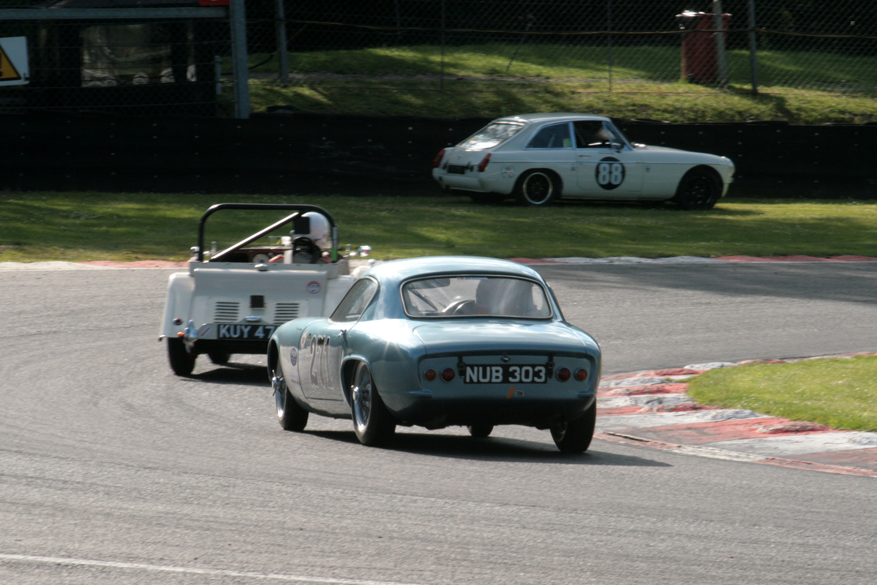 Druids, and Brian Arculus is about to lap Mark Shears. Note Harry Brown's MGB GT parked up having retired on lap 6.