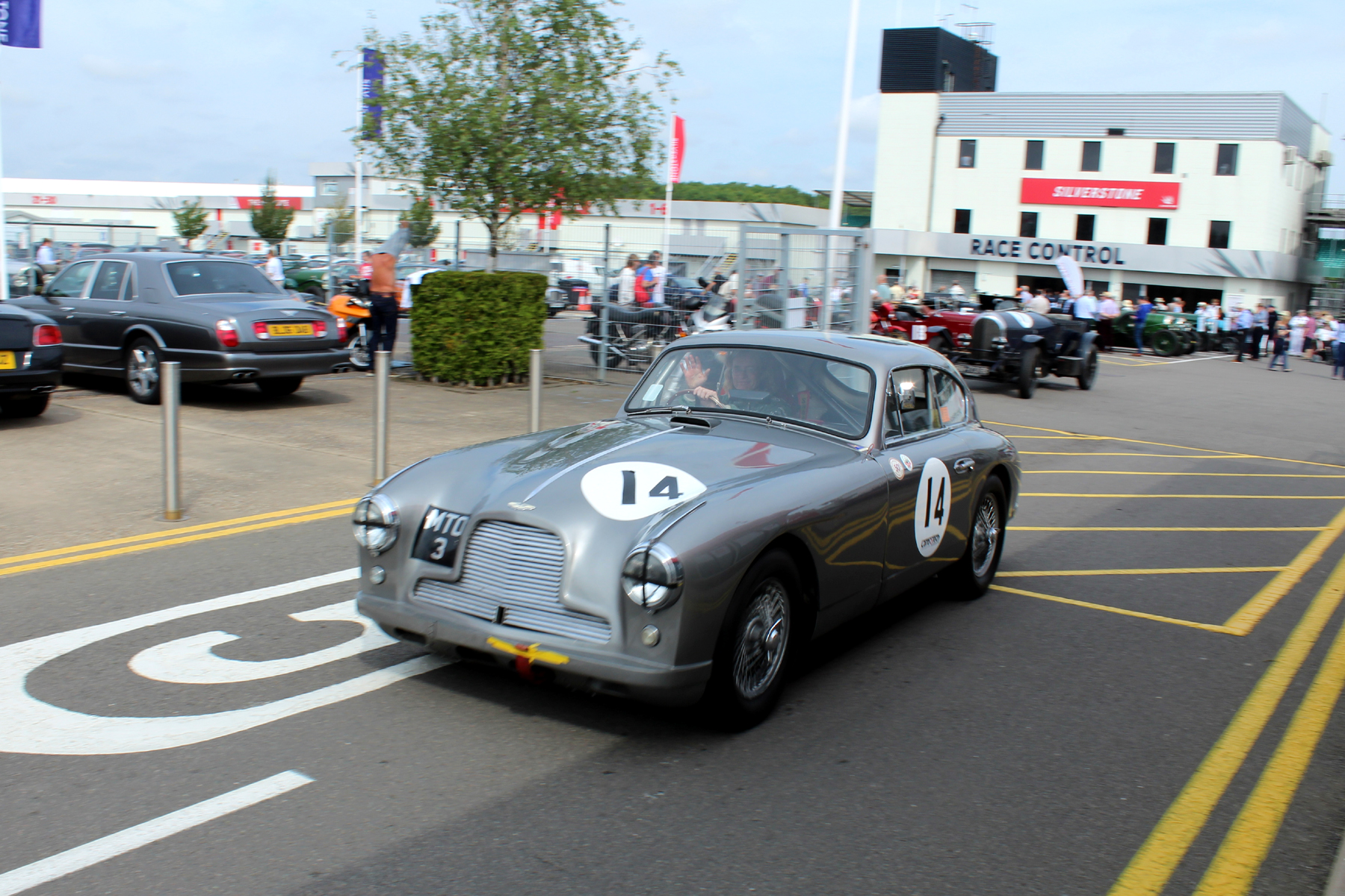 Tim Stamper, in Richard Bell's Aston Martin DB2/4 follows Alex out, and has time to wave to the photographer! Photo - JT