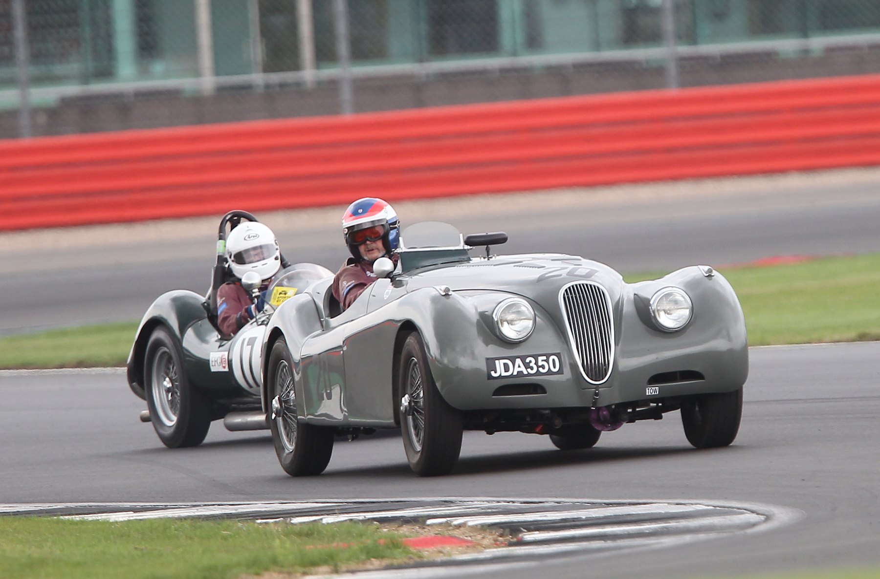 Another was that between John Harper in the XK120 and Alex Quattlebaum in the LECo, until the pitstops intervened. They even have matching race suits!  Photo - Mick Walker