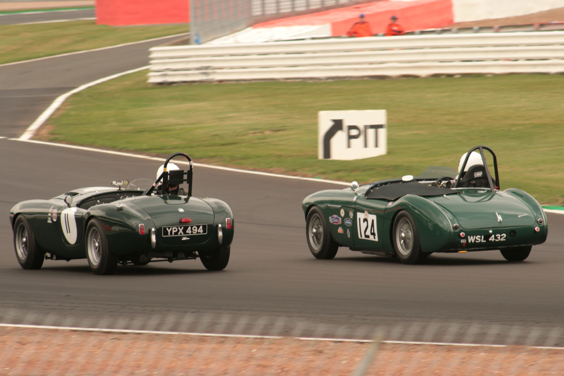 Tim Pearce & Jim Campbell dice it out through Woodcote  Photo - JT
