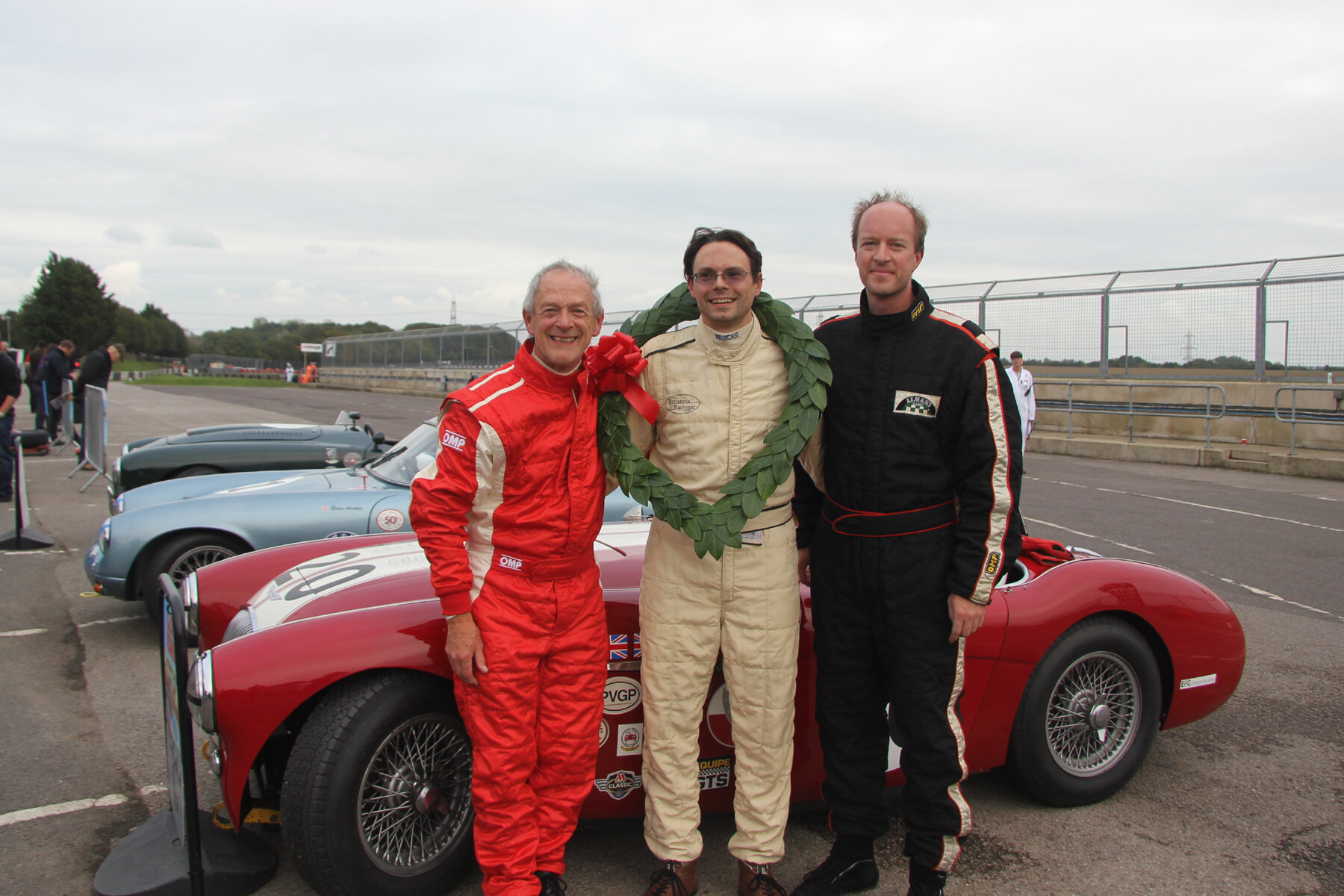 Brian Arculus, Jonathan Abecassis & Robin Pearce celebrating their fine race  Photo - Pat Arculus, Tripos Media