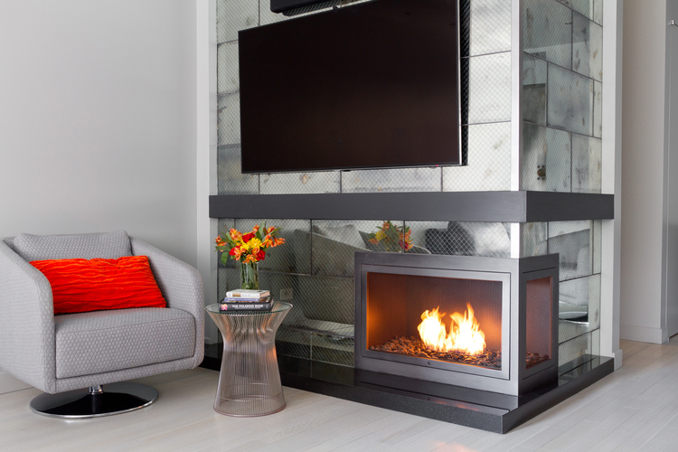 Corner HearthCabinet Ventless Fireplace, finished in custom pewter powder coated steel | Designer: Rick Trabucco
