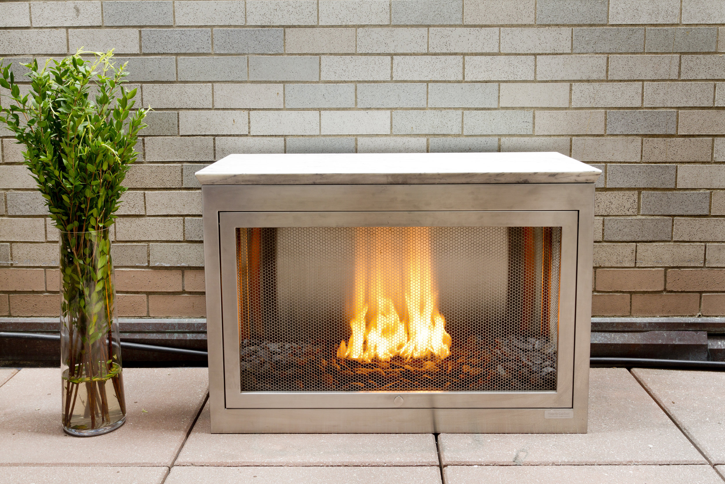 3-sided Landscape HearthCabinet Ventless Fireplace, finished in stainless steel