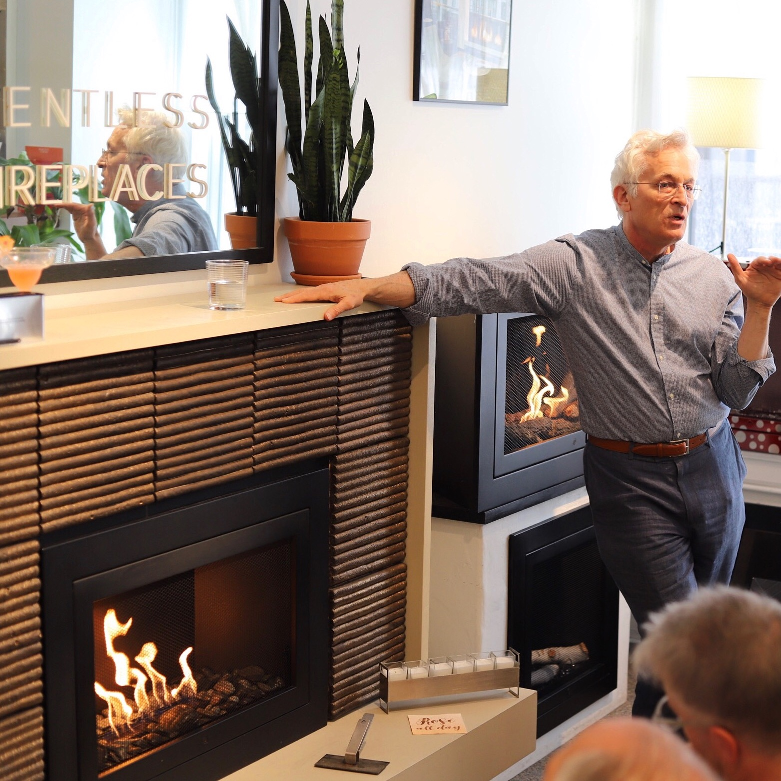 Pictured: Arthur Lasky, HearthCabinet® founder & NCARB  Fireplace surround designed by  Wesley Moon  with custom exterior tile by  Cocobolo Design