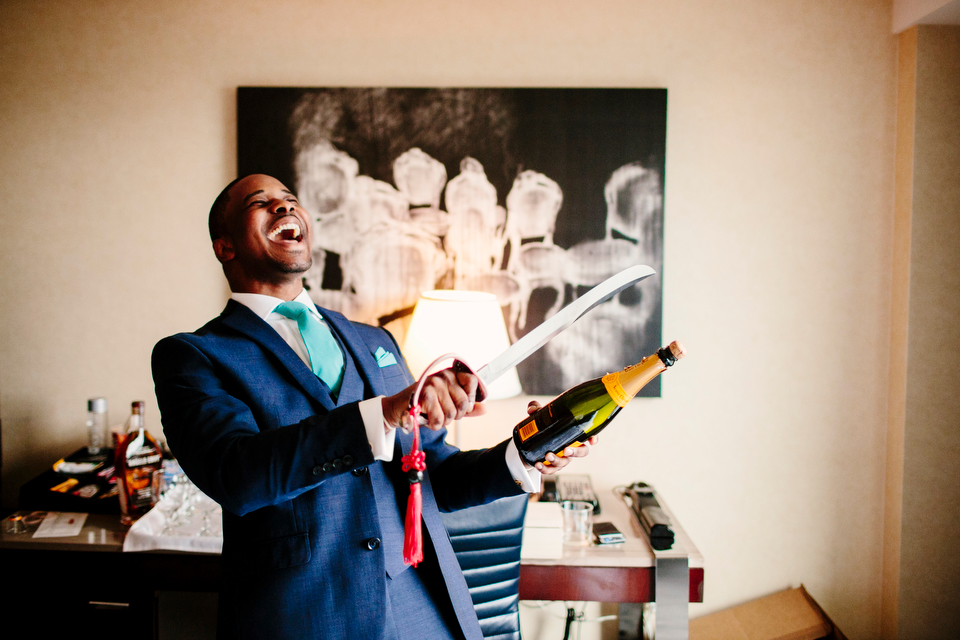 The Groom opening Champagne with a Sword