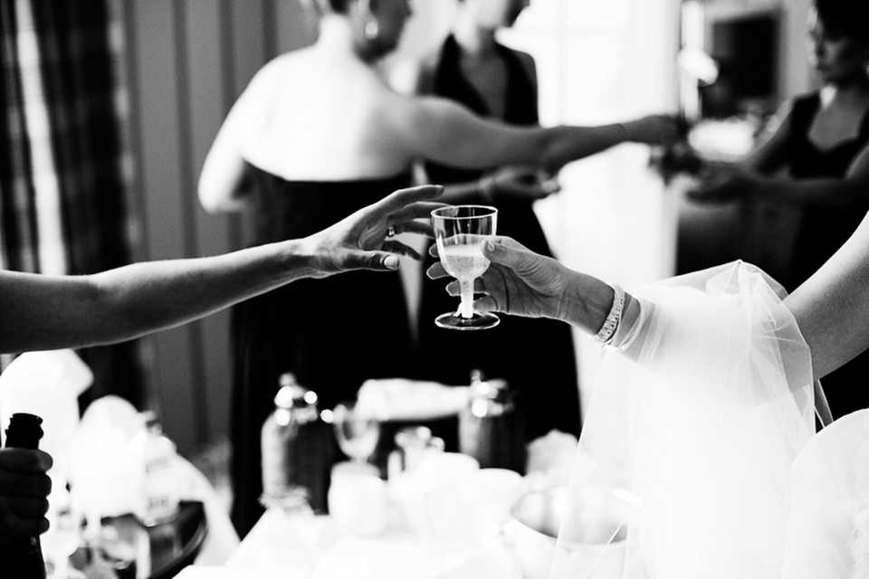 The bride and bridesmaids share a quick drink before the ceremony.