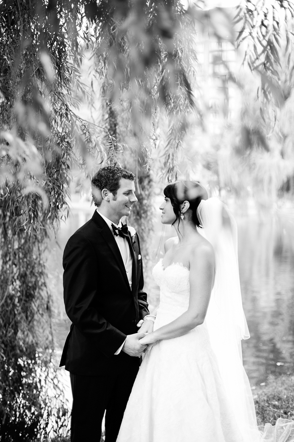 A black and white outdoor wedding portrait of the bride and groom in Boston, MA.