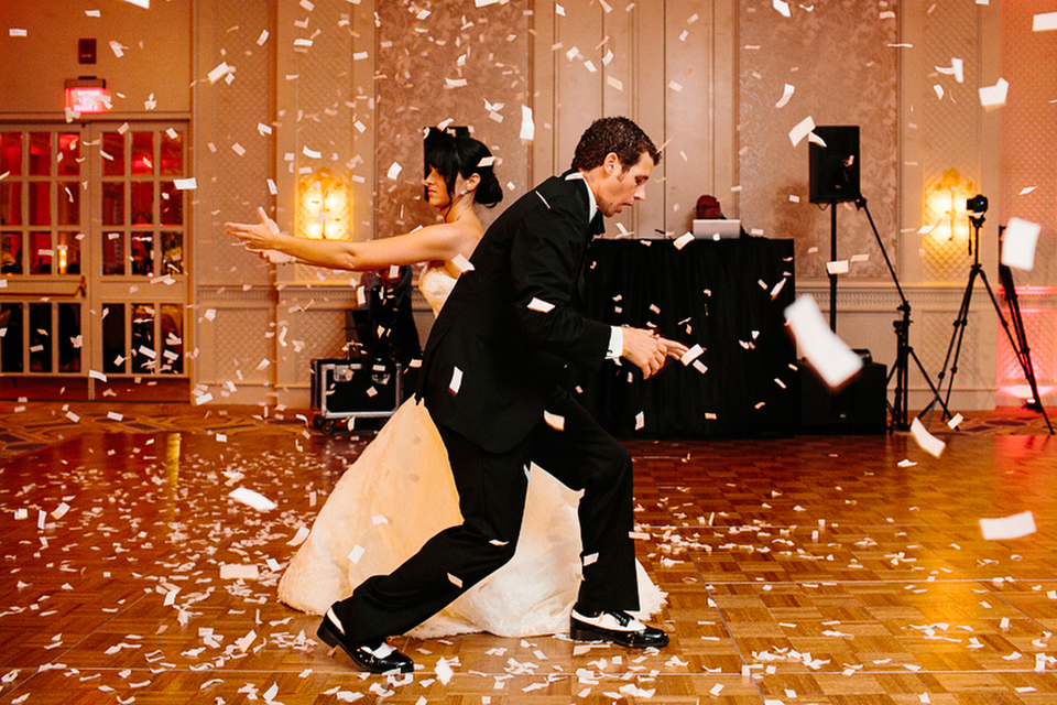 Confetti blankets the dance floor during the bride and groom's first dance.