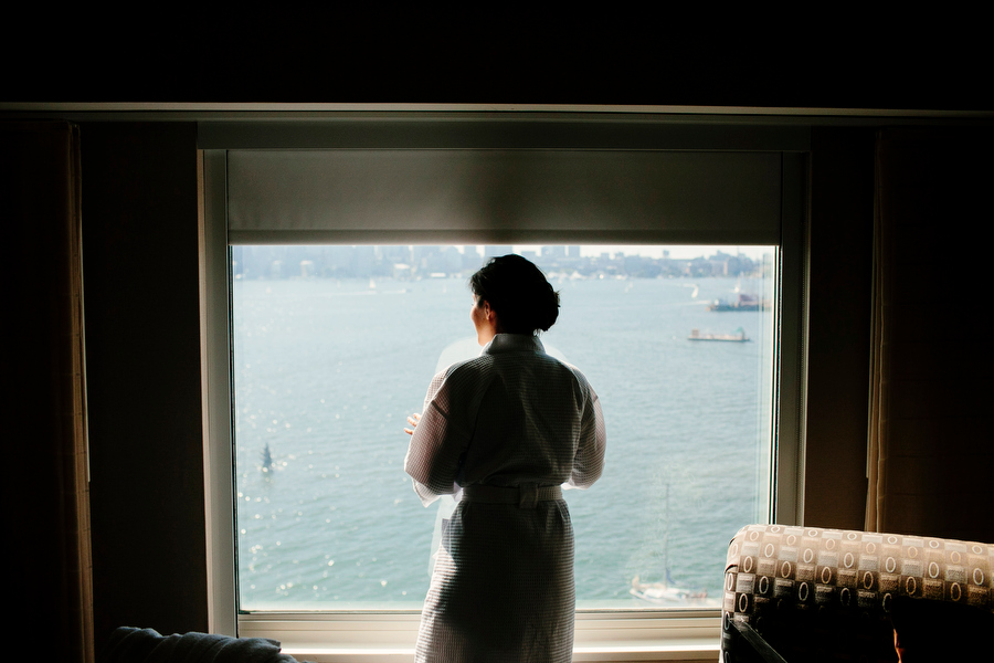 bride prep looking out window