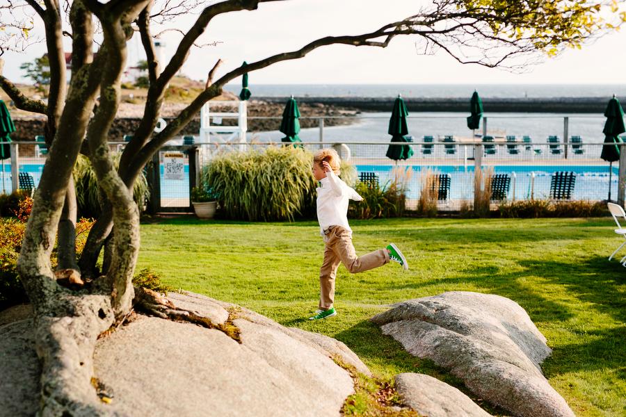 boy running outside flag