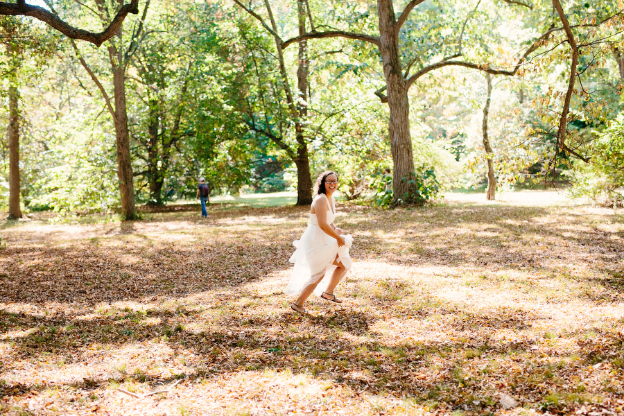 bride running in the leaves