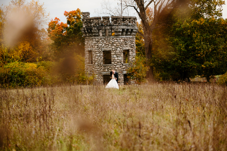 bride and groom with ruins
