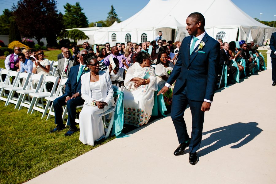 groom walking down aisle