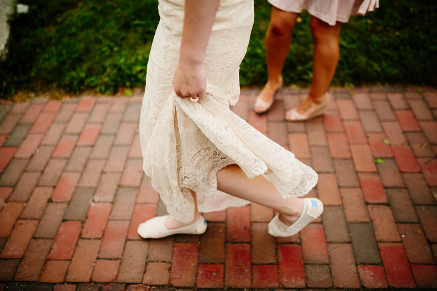 bride in toms shoes walking to ceremony
