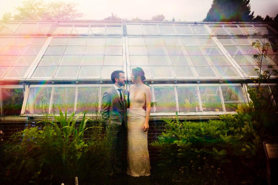 bride and groom greenhouse portrait