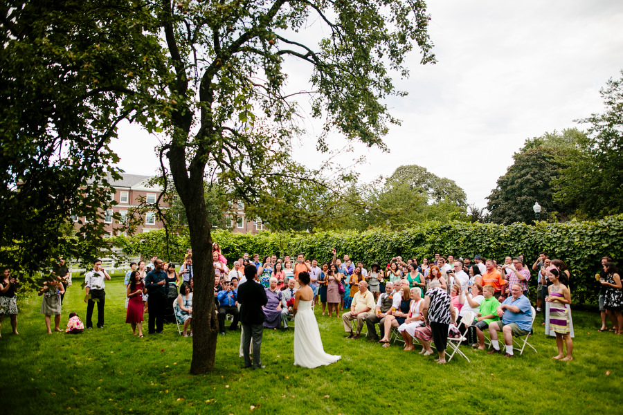 outdoor ceremony with guests standing
