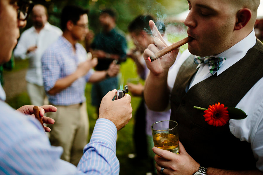 groom and cigars at wedding