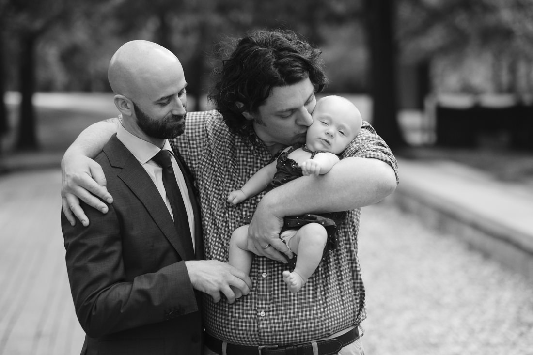 groom with guest and baby at wedding at charles river museum of industry and innovation in waltham, ma near boston