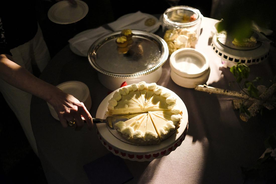 guest serving pie at dessert table in western massachusetts wedding, stockbridge
