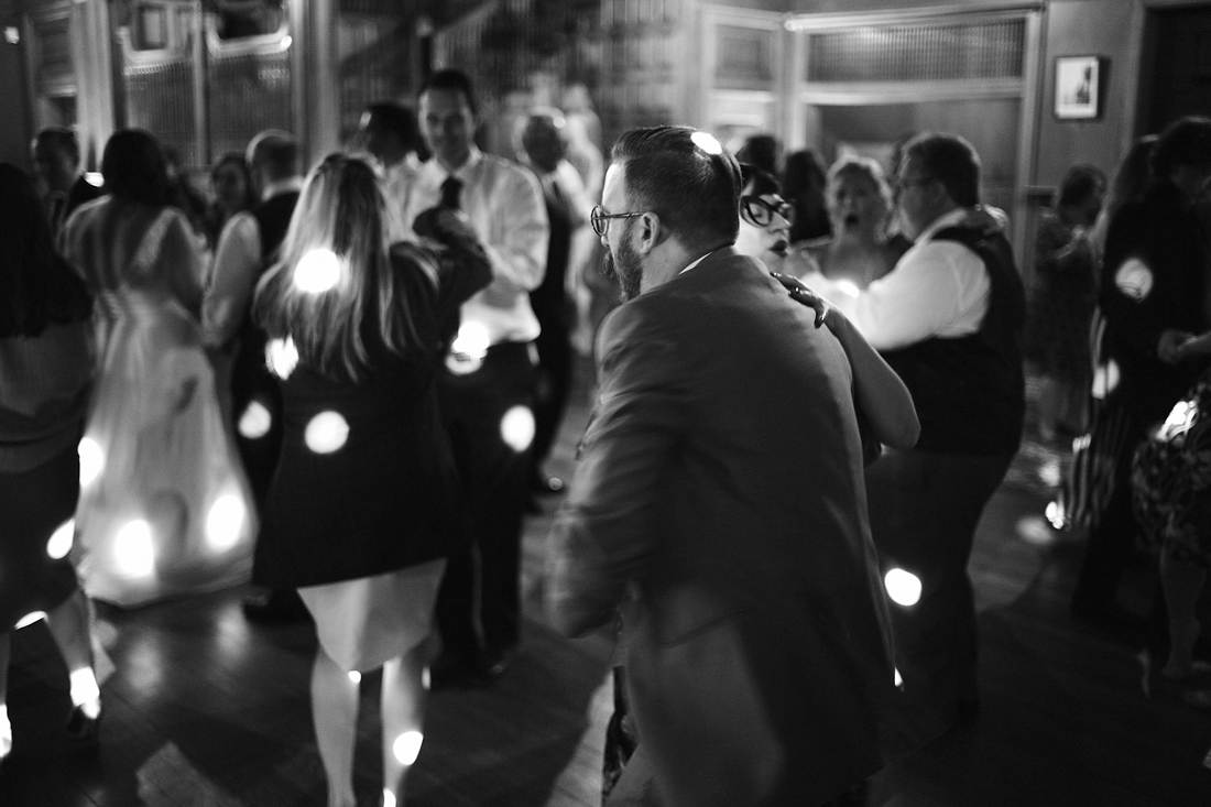 dancing guests under spotted lights at the stonehurst robert treat paine estate wedding reception
