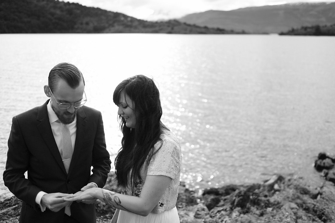 groom puts ring on bride at wedding elopement in patagonia chile during destination edding