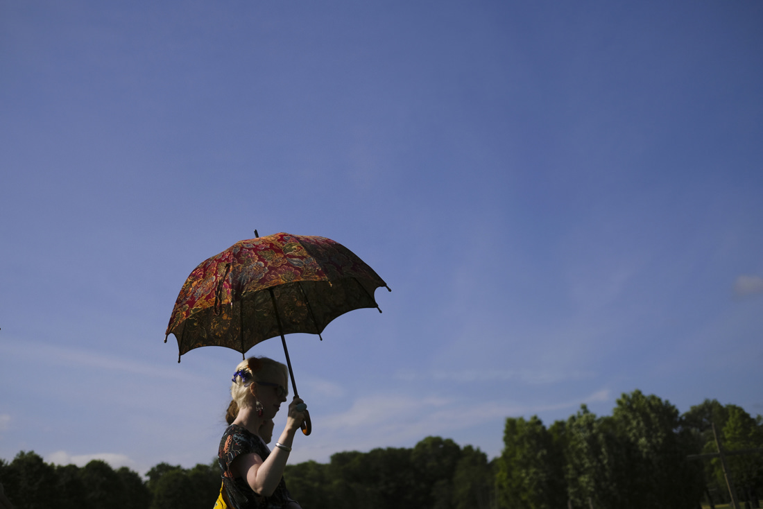 woman with umbrella at vermont wedding at the path of life sculpture garden