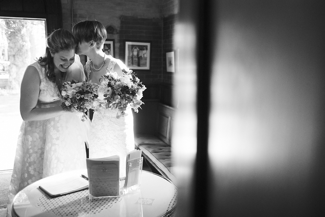 bride whispers to her new wife at wedding in the berkshires