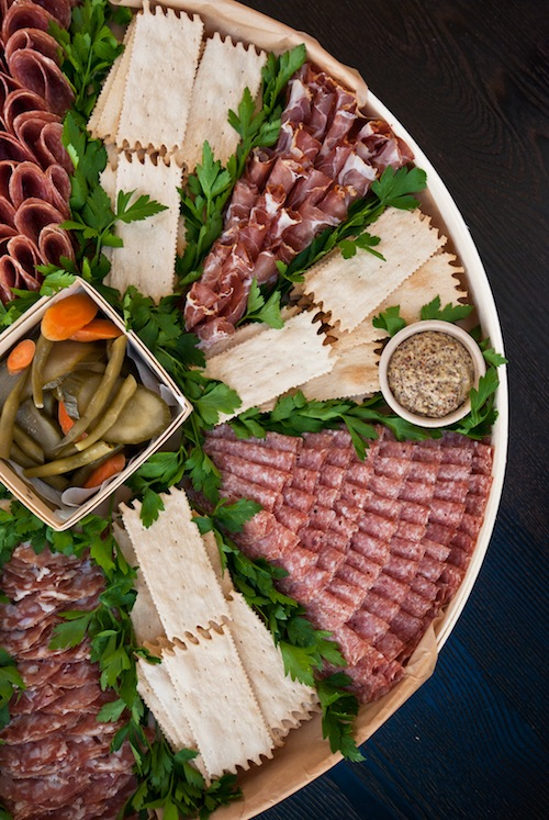partial shot of signature large salumi platter - feeds 20 to 30 people