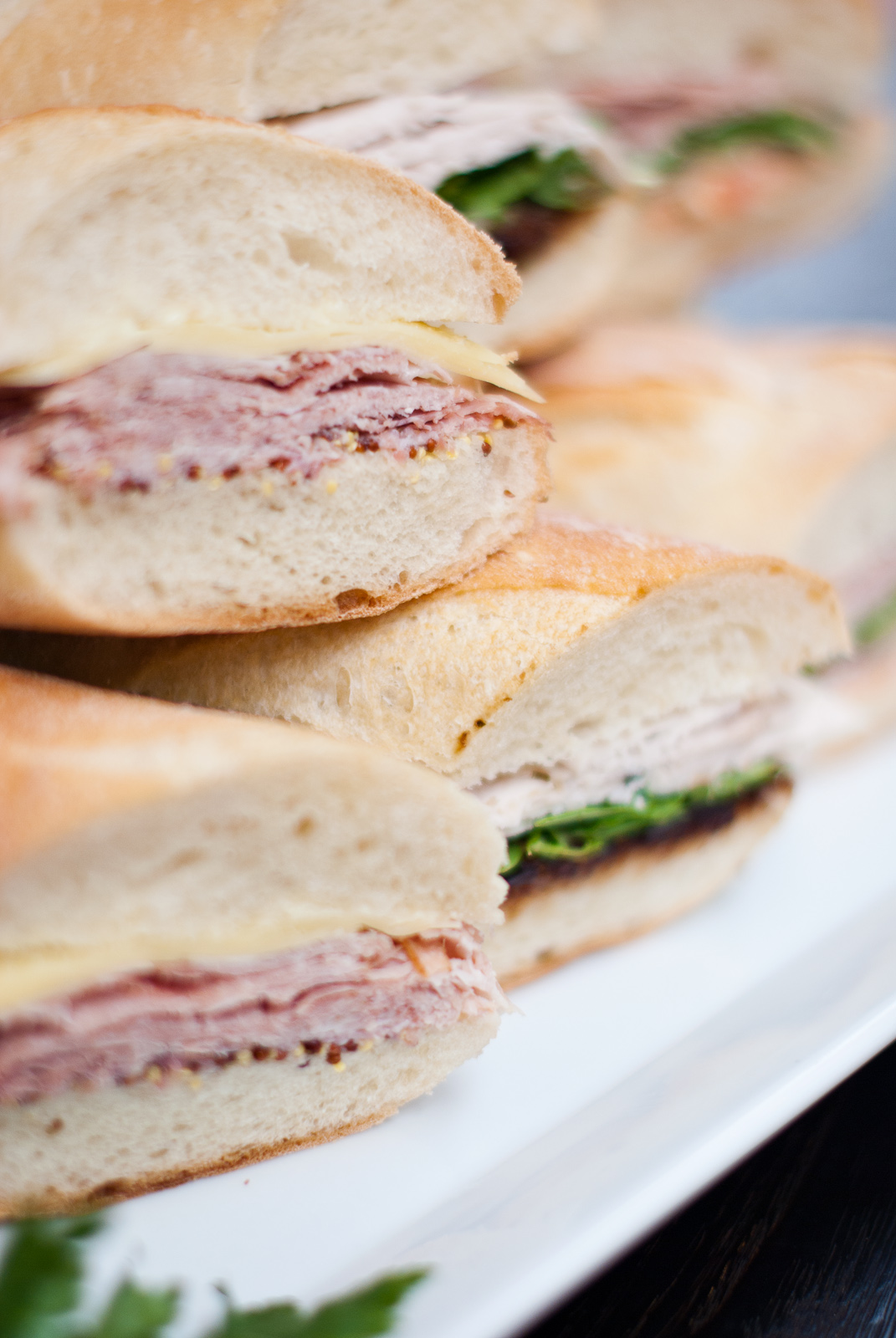 close up of our catered European style baguette sandwiches cut in half