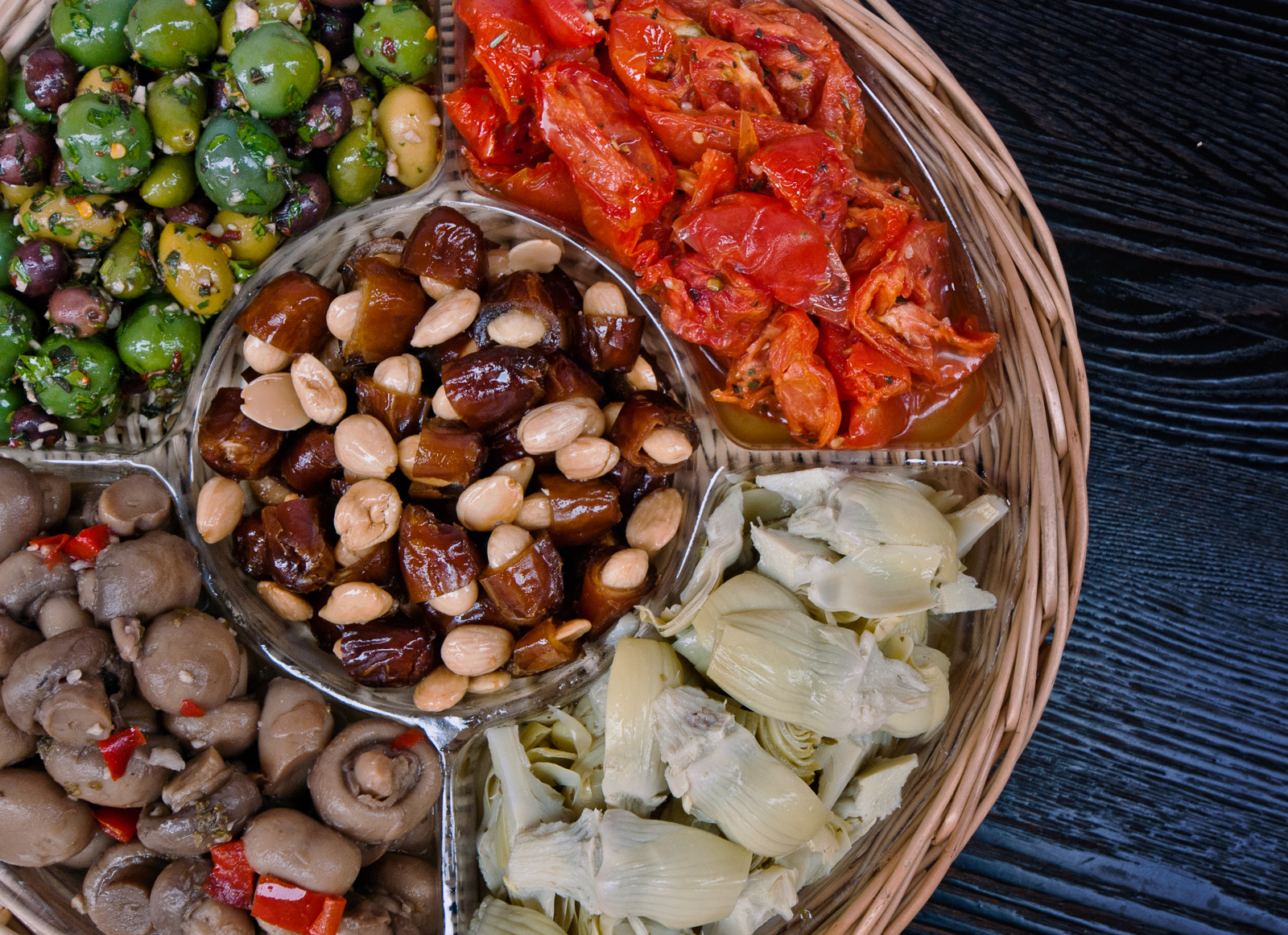 antipasti platter with Marcona almonds and dates in center
