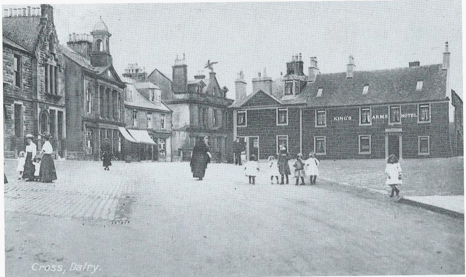Dalry Square, the Parish school used to be on the site and is now the local library, on left. The King's Arms on right hand side was once the town's main coaching inn.