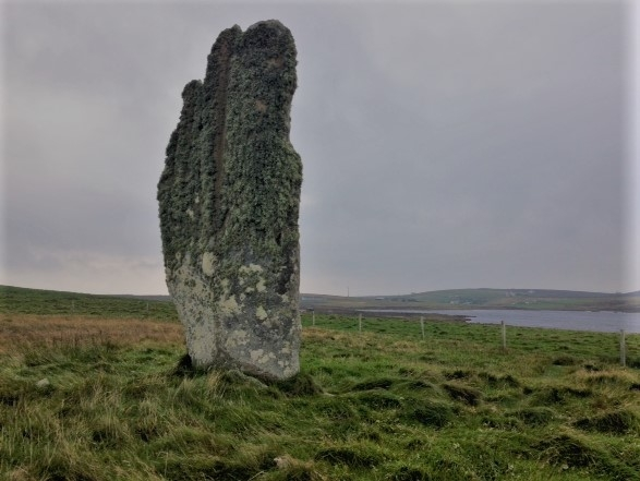 The Stone of Setter. Approximately 17 foot high, at the North end of Eday, between the Bay of Calf Sound and Mill Loch, it is probably one of the finest prehistoric single standing stones in Orkney.